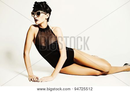 Fashion Girl Wearing Swimming Suit In The Studio