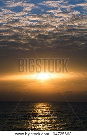 Dramatic sunset with dark clouds in the sea