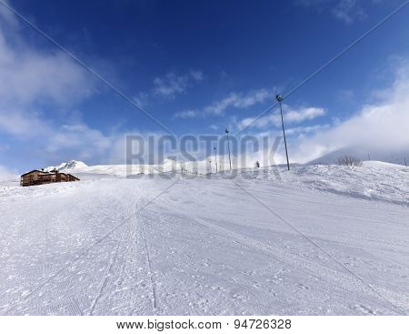 Ski Slope And Hotel In Winter Mountains