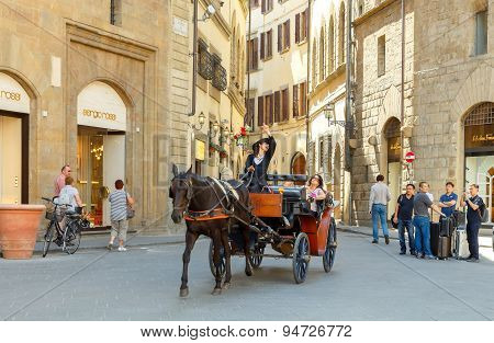 Florence. Walk In The Horse-drawn Carriage Through The City.