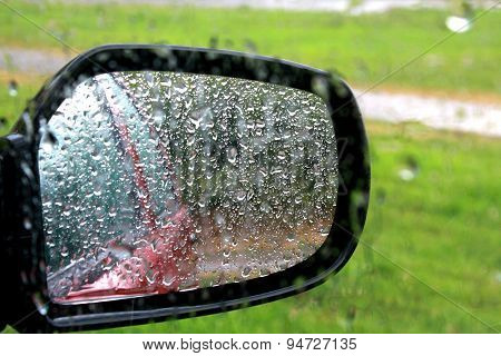 Closeup Of Car Window And Mirror With Rain Drop