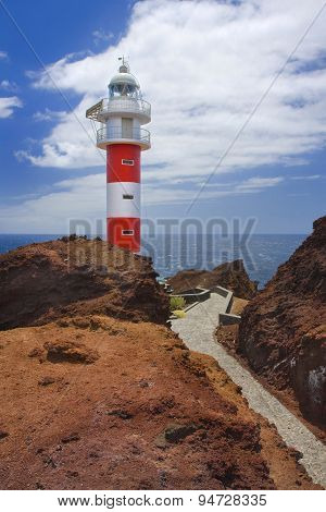 Red And White Lighthouse On The Rocks