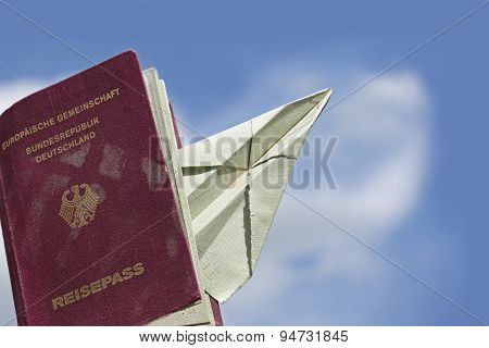 Sed Passport From Germany With A Paper Airplane Against The Blue Sky