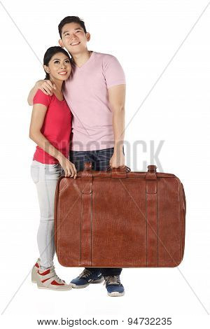 Young Couple Carrying Baggage