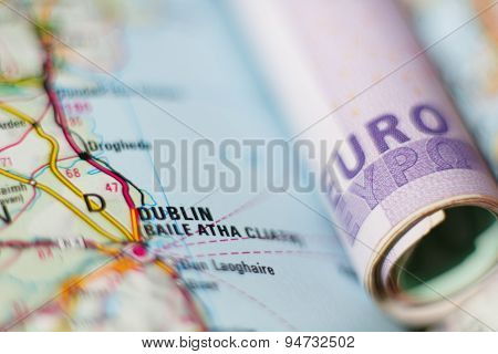 Euro Banknotes On A Geographical Map Of Dublin