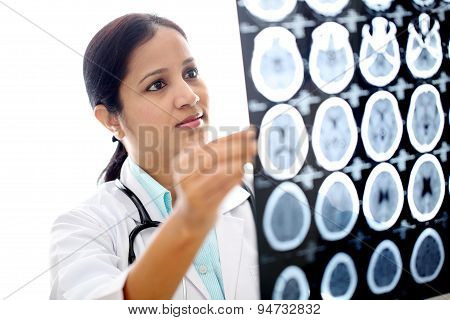 Female Doctor Examining A Brain Computerized Tomography Scan