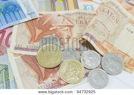 Greek Drachma And Euro Banknotes On White