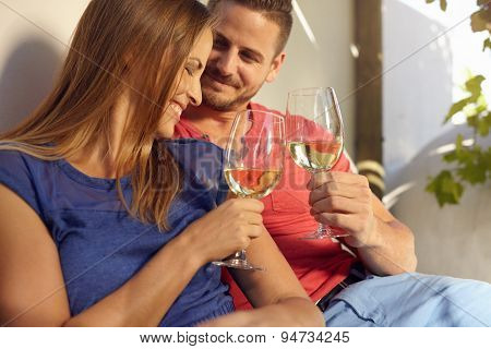 Smiling Young Couple Celebrating With Wine