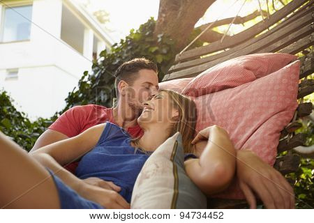 Romantic Couple Outdoors Relaxing On A Hammock