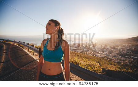 Female Athlete Taking A Break After Hard Outdoor Training