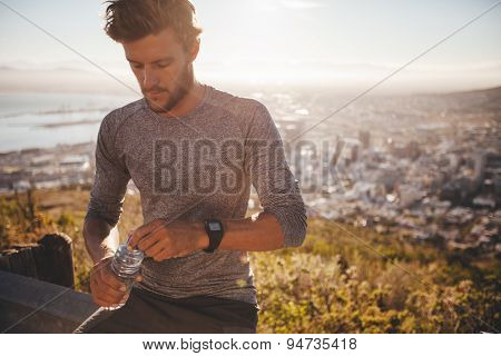 Runner Taking Break And Drinking Water