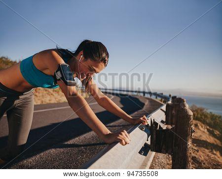 Tired Runner Taking A Break Leaning Guardrail