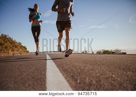 Runners Training On Country Road