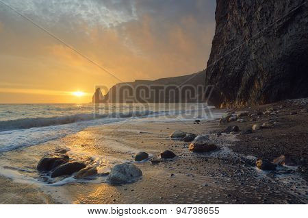 Seascape with rocks on the shore. Beautiful sunset. Crimea