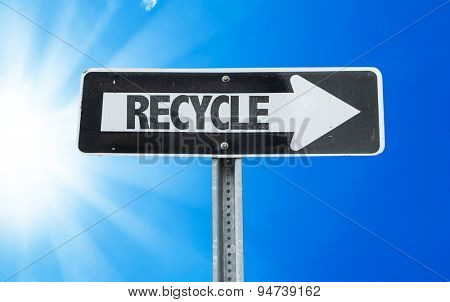 Recycle direction sign with a beautiful day