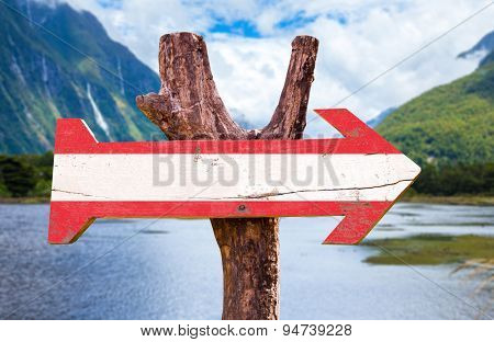 Austria flag wooden sign with countryside background