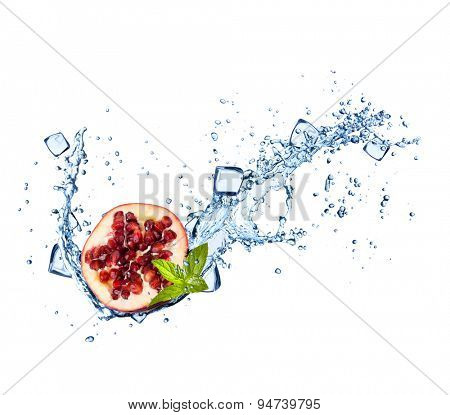 Pomegranate in water splashes and ice cubes isolated on white background