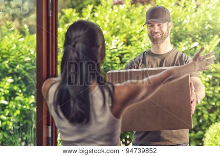Woman Taking Delivery Of A Large Parcel