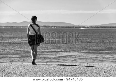 Brunette girl on the shore of Tagus, River, Portugal, Europe