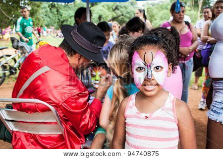SAO PAOLO, BRAZIL - APRIL 21, 2015: Unidentified girl with face paintig on April 21, 2015  in Ibirapuera Park, Sao Paolo, Brazi. Ibirapuera Park is the largest park in the city .