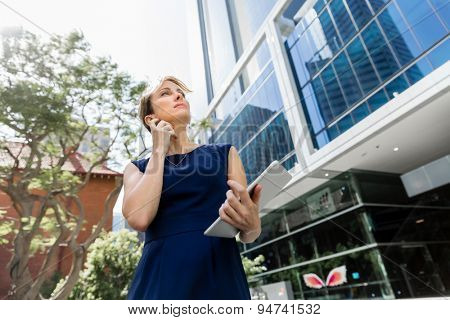 Businesswoman standing next to her office in the morning