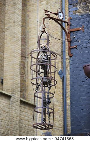 LONDON, UK - JUNE 23: Replica of skeleton in cage at the entrance to The Clink prison museum, which exhibits medieval torture tools. June 23, 2015 in London.