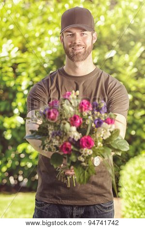 Bearded 20S Man Holding Bunch Of Flowers