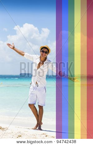 Celebrating marriage equality, handsome man at the beach with the LGBT flag overlapped on a side with medium opacity.