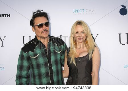 LOS ANGELES - JUN 24:  David LaChapelle, Pamela Anderson at the