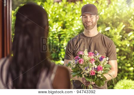 Bearded 20S Man Delivers Flowers To Young Woman