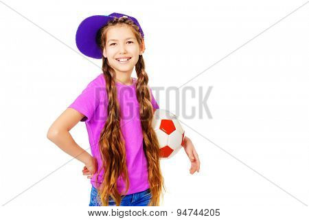 Happy smiling girl teenager wearing casual clothes posing with a football. Active lifestyle. Studio shot. Isolated over white.