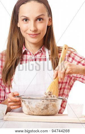 young woman knead the dough, isolated on white background