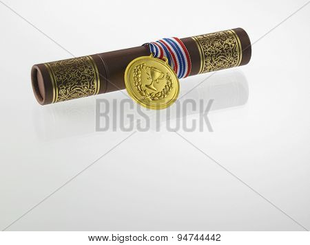certificate and golden medal on the white background