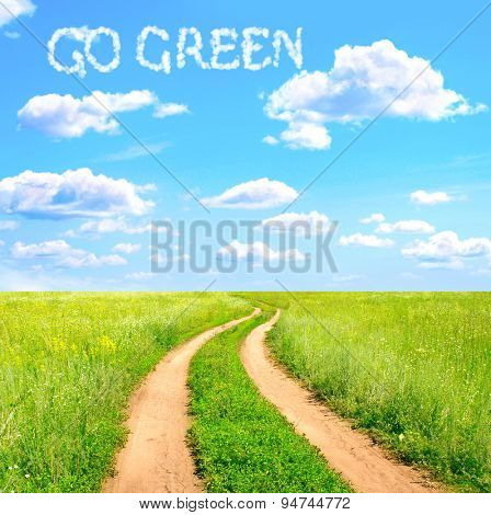 Rural summer landscape with road and words Go Green in the clouds