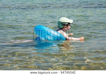 Little boy swimming with