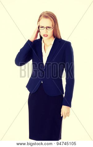 Businesswoman with a huge headache