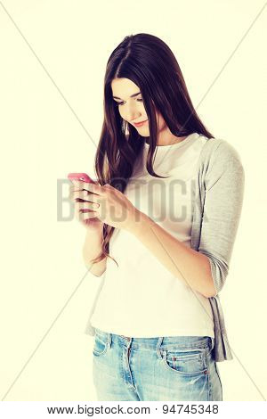 Brunette teen texting to someone