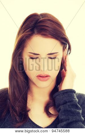 Young brunette woman with a headache