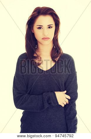 Young beautiful woman looking angry