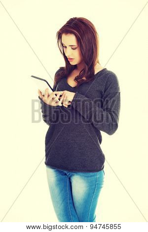 Young woman surfing on tablet