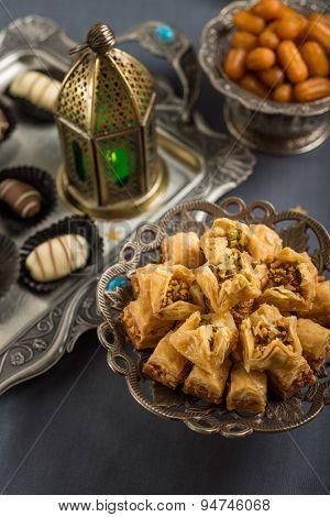Mediterranean baklava, date-chocolates, balah and Ramadan lamp. A festive food.