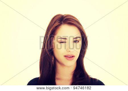 Young brunette woman blink eye
