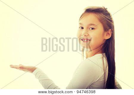 Little cute brunette girl showing something