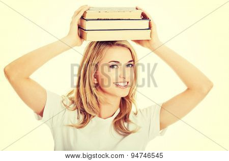 Student woman with books on her head