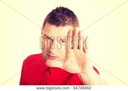 Handsome man pressing an abstract touchscreen button