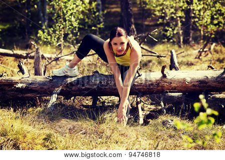 Beautiful woman stretching after running