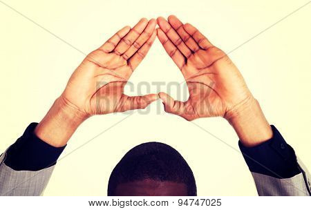 Black man gesturing heart sign