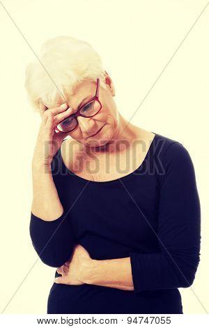 Beautiful fit senior woman depressed