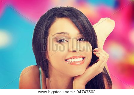 Portrait of a happy tanned woman looking at the camera