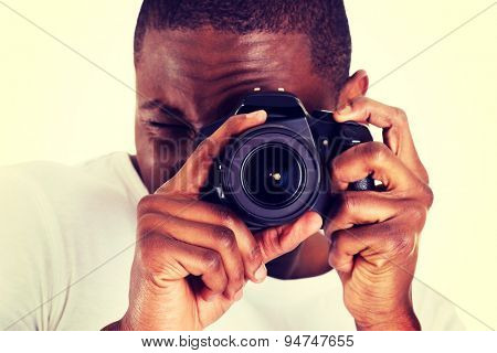 Young black man photographer doing photos